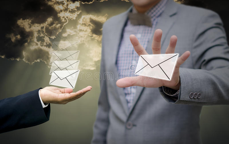 Businessman get email in hand royalty free stock photography