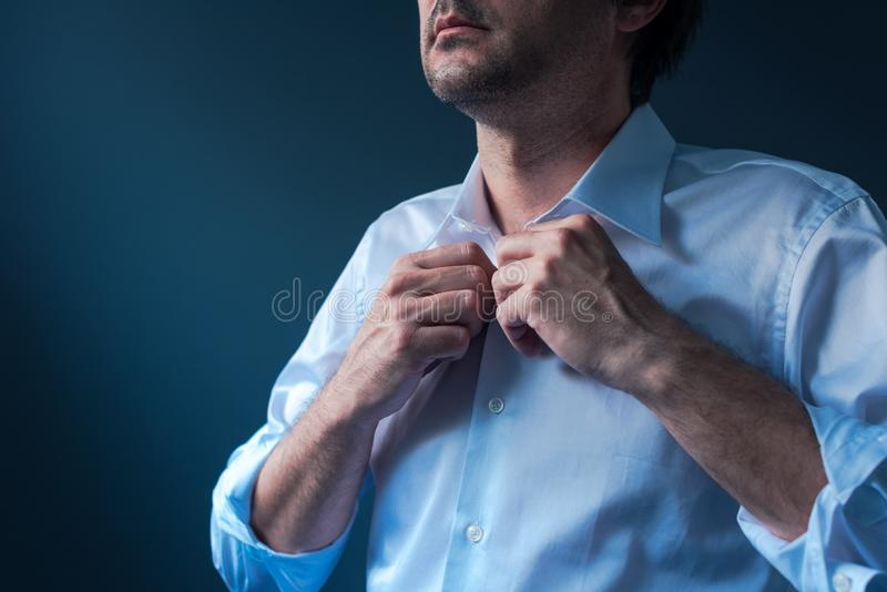 Businessman getting dressed for job interview stock photo