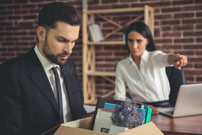 Businessman getting fired royalty free stock images