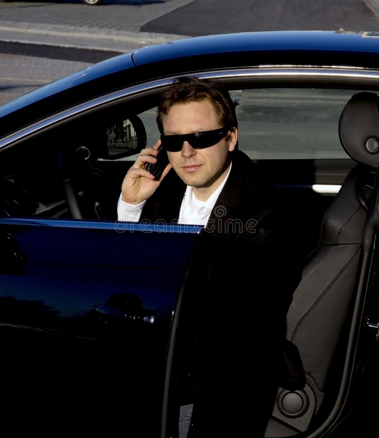 Businessman Getting Out Of A Car Stock Image