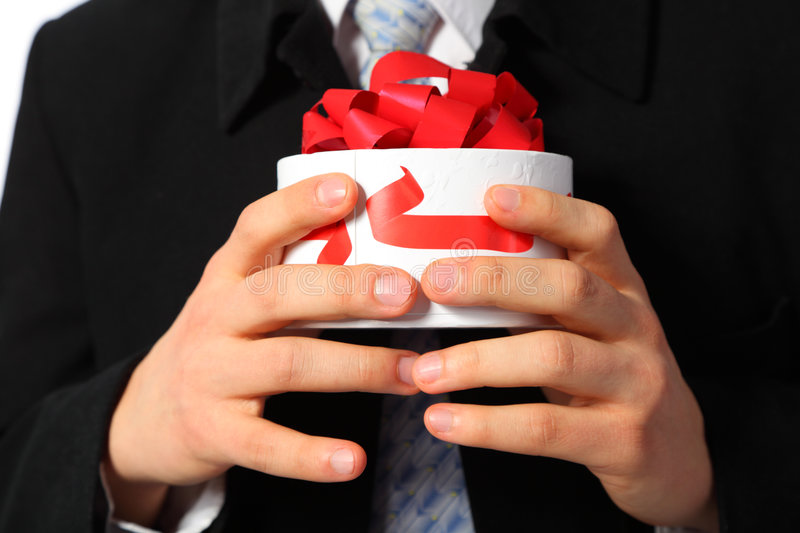 Businessman with gift box in hands stock photos