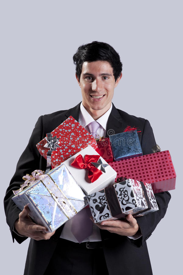 Businessman with a gift package royalty free stock photography