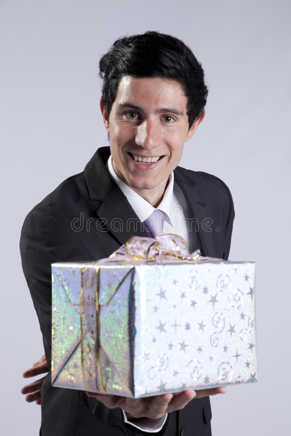 Businessman with a gift package stock photo
