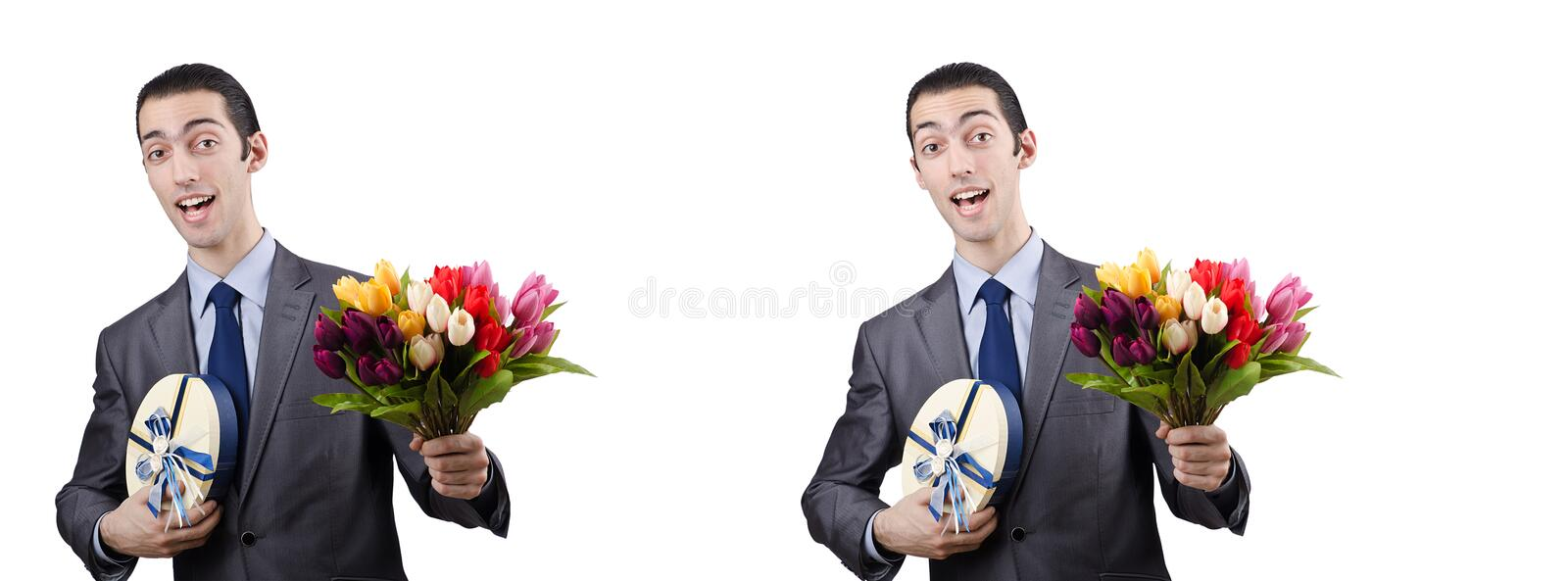 The businessman with giftbox and flowers. Businessman with giftbox and flowers royalty free stock images
