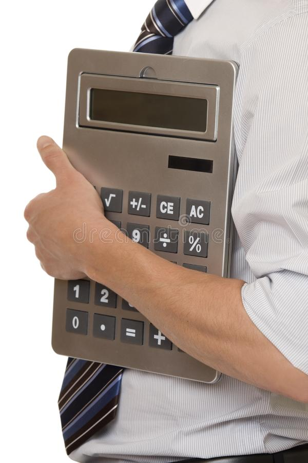 Businessman with gigantic pocket calculator stock photography