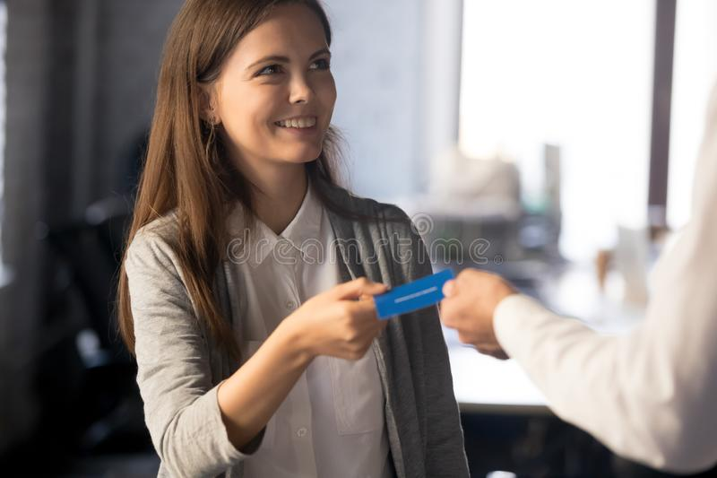 Businessman give business card to excited female employee royalty free stock photos