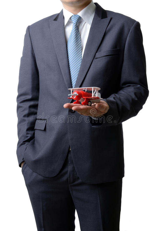 Businessman gives the model airplane to the customer isolated on royalty free stock images