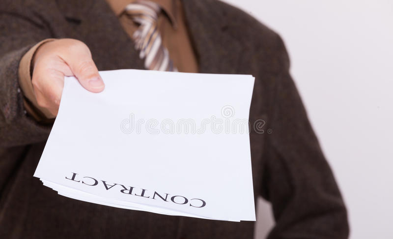 Businessman giving blank paper with sign contract. Business concept signing contract. Businessman giving blank empty paper sheet with sign contract and space for stock photo