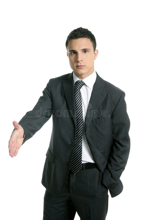Businessman Giving Hand Facing To Camera Royalty Free Stock Image