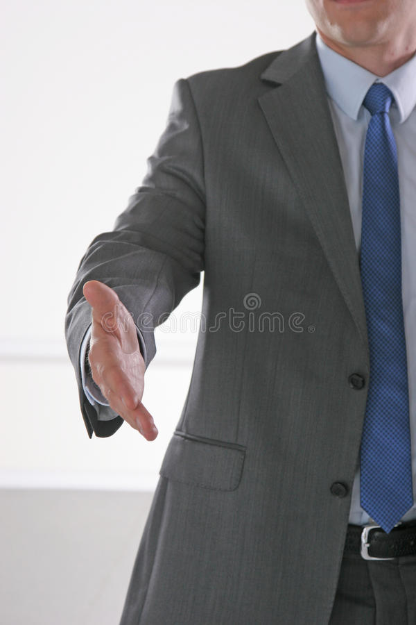 Businessman giving hand for handshake, isolated on white background.  royalty free stock photo