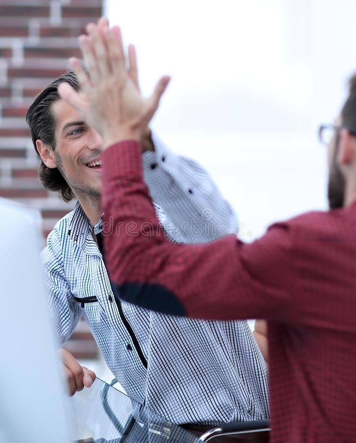 Businessman giving high five to his partner royalty free stock photo