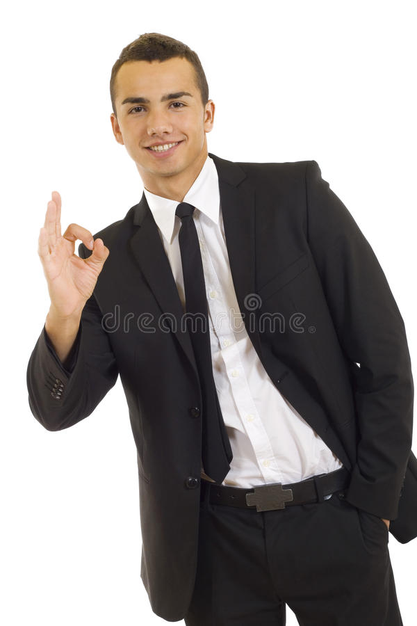 Businessman giving OK gesture royalty free stock photo