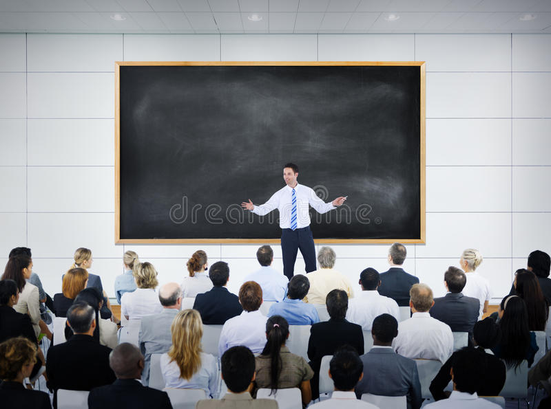 Businessman Giving Presentation in Board Room stock photo