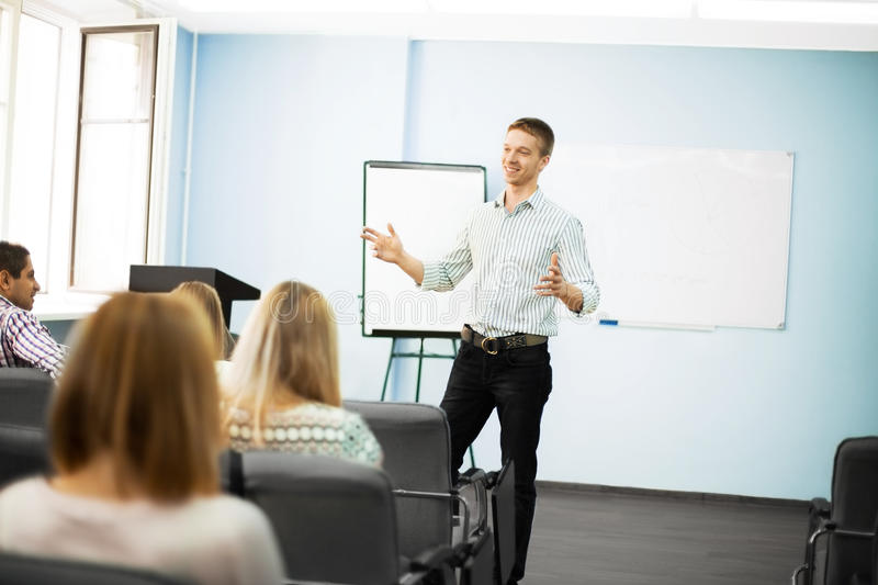Businessman giving a presentation on flipchart. royalty free stock images