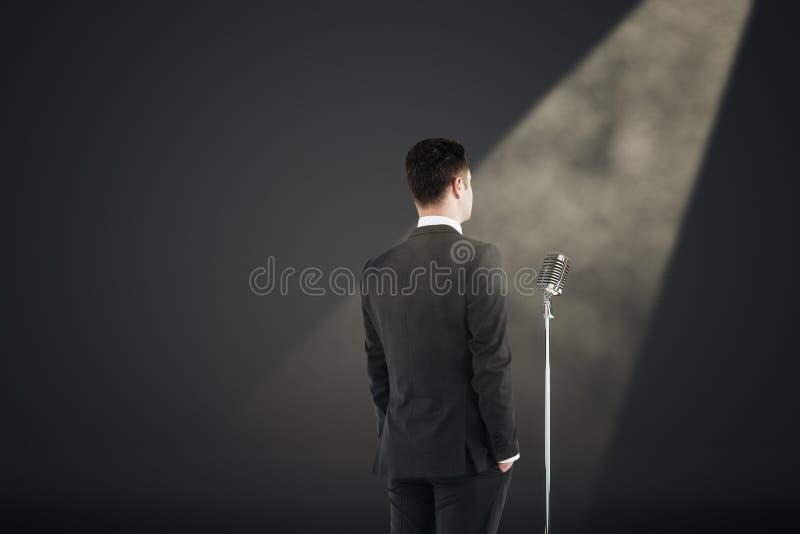 Businessman giving speech stock photos