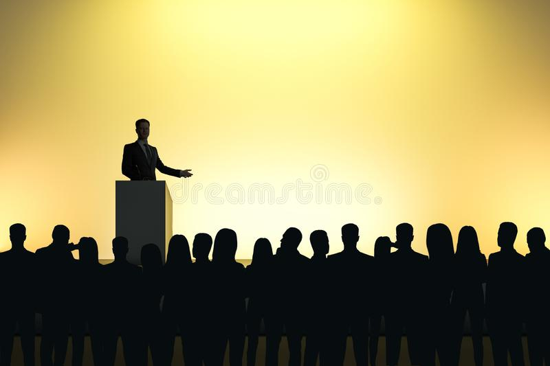 Businessman giving speech. In front of backlit audience on light yellow background. Speaker and leader concept stock photos