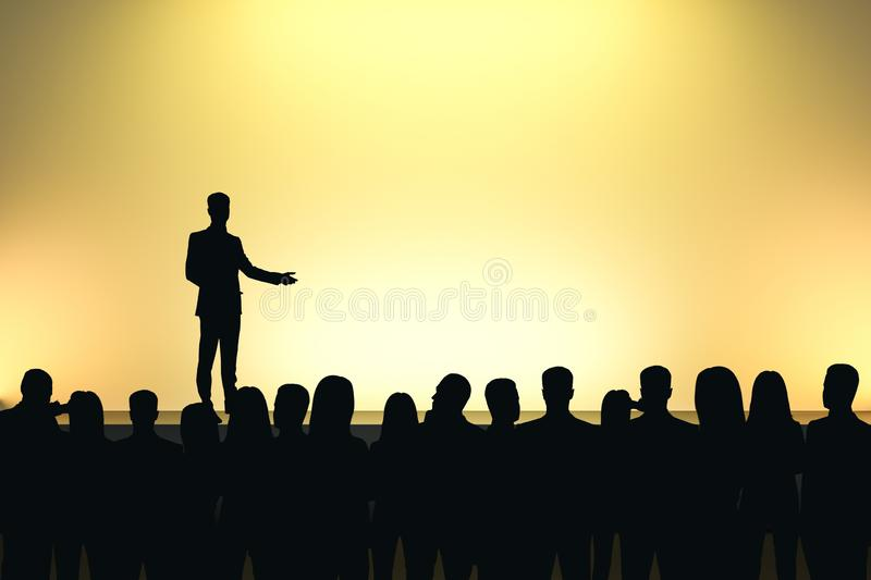 Businessman giving speech. In front of backlit audience on light yellow background. Speaker and motivation concept stock image