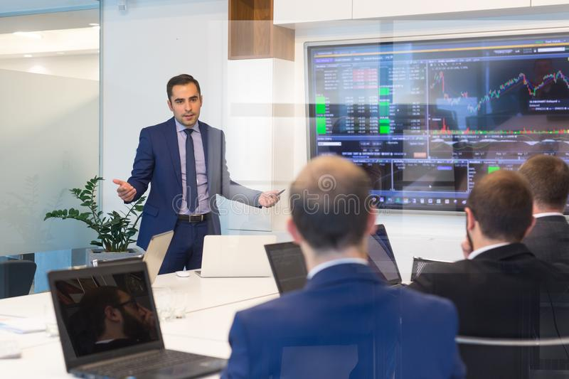 Business presentation on corporate meeting. Corporate business concept. Businessman giving a talk in conference room. Business executive delivering presentation stock photos