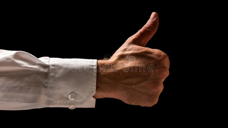 Businessman giving a thumbs up stock photo