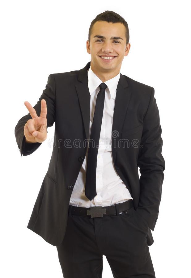 Businessman giving the victory sign royalty free stock image