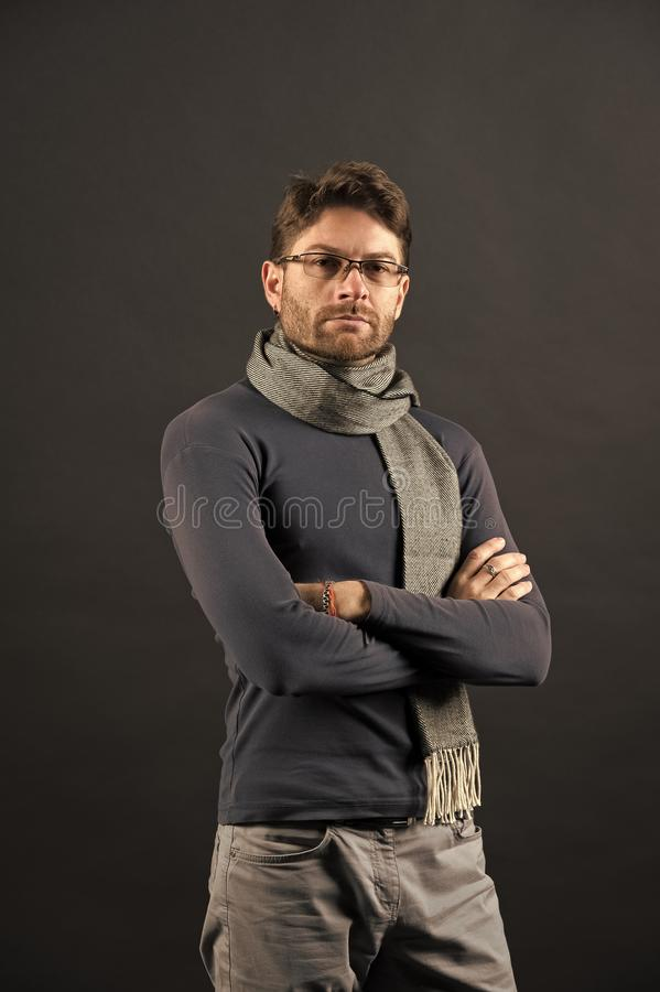 Businessman in glasses on bearded face. Man in scarf and sweater with folded hands. Fashion, eyewear, accessory. Vision, business, future concept. Eyesight royalty free stock photography