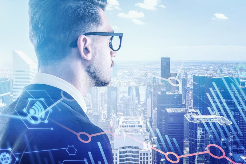 Businessman in glasses in city, digital graphs stock images