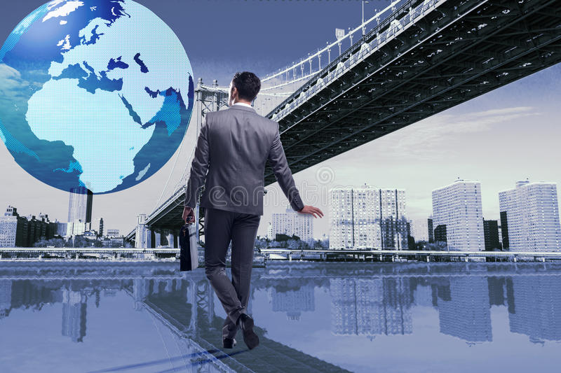 The businessman in global business concept. Businessman in global business concept royalty free stock image
