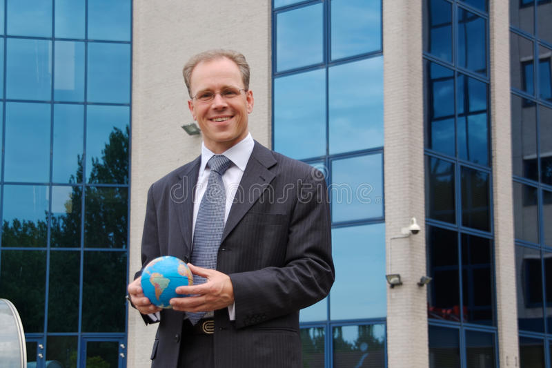 Businessman with globe in hand stock image