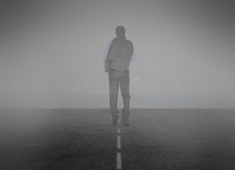 Businessman goes into the mist. Smoke. Businessman goes into the mist royalty free stock image