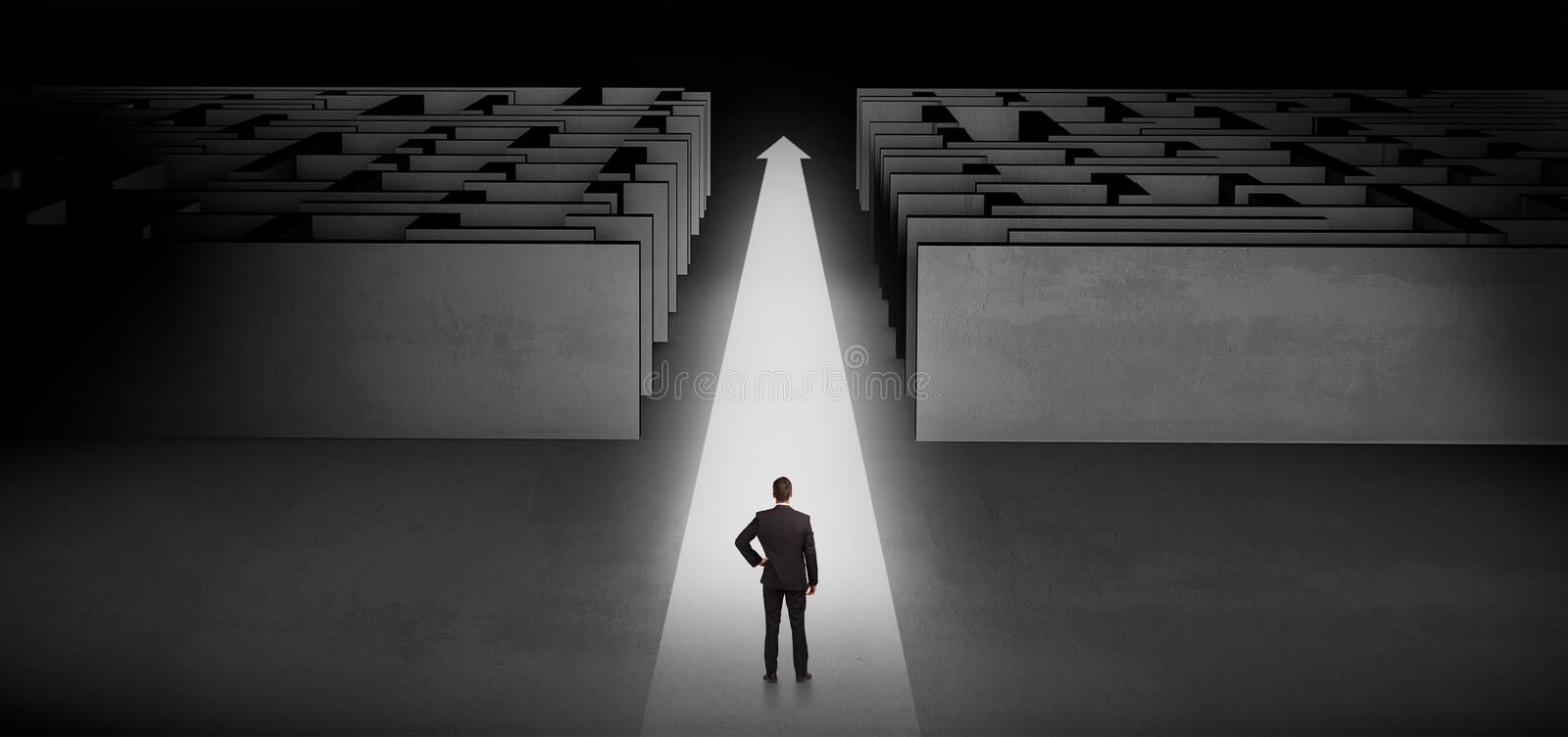 Businessman going straight ahead between two mazes. Businessman going straight ahead on a lighted carpet arrow between two mazen royalty free stock images