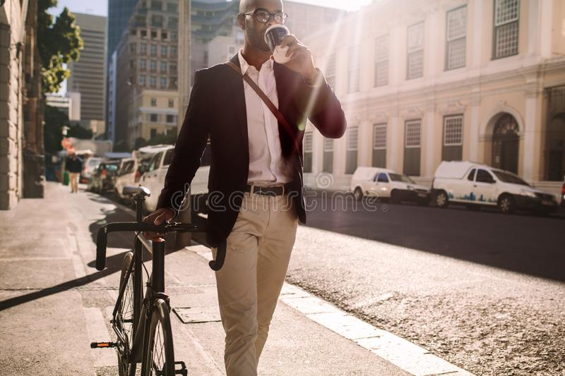 Businessman going to work by bicycle royalty free stock photography