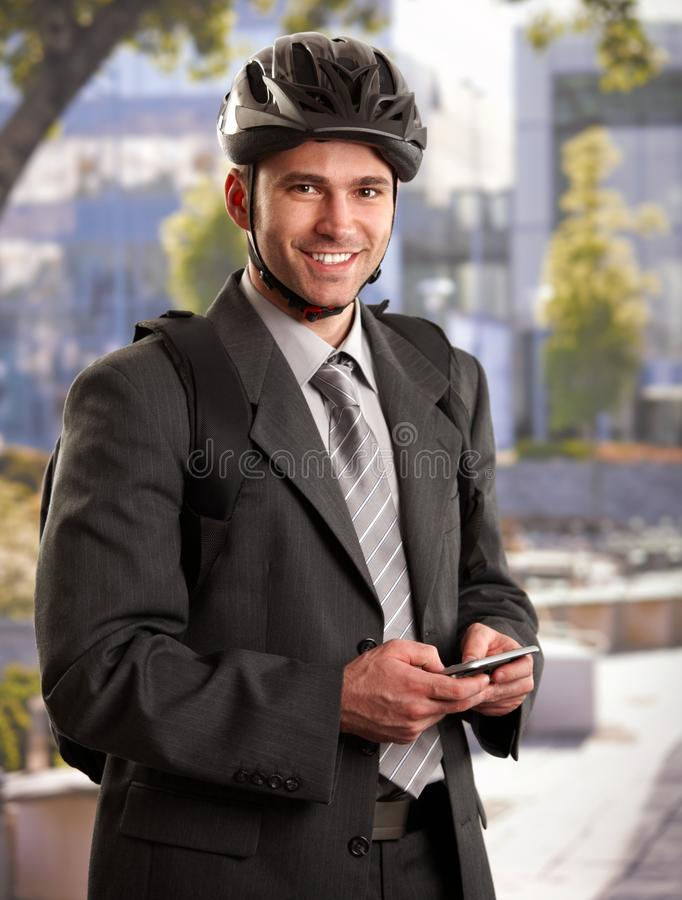 Businessman going to work by bike stock photography