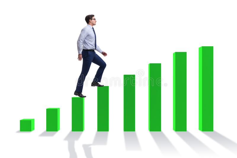 The businessman going up the bar chart in growth concept stock photography