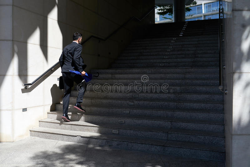 Hurrying businessman stock images