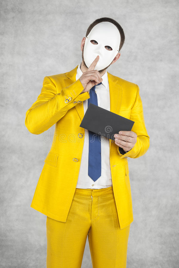 Businessman in a gold suit, asks for secrecy. Incognito person royalty free stock photos