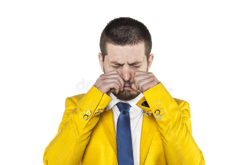 Businessman in a gold suit crying. Business man in a gold suit crying stock photography