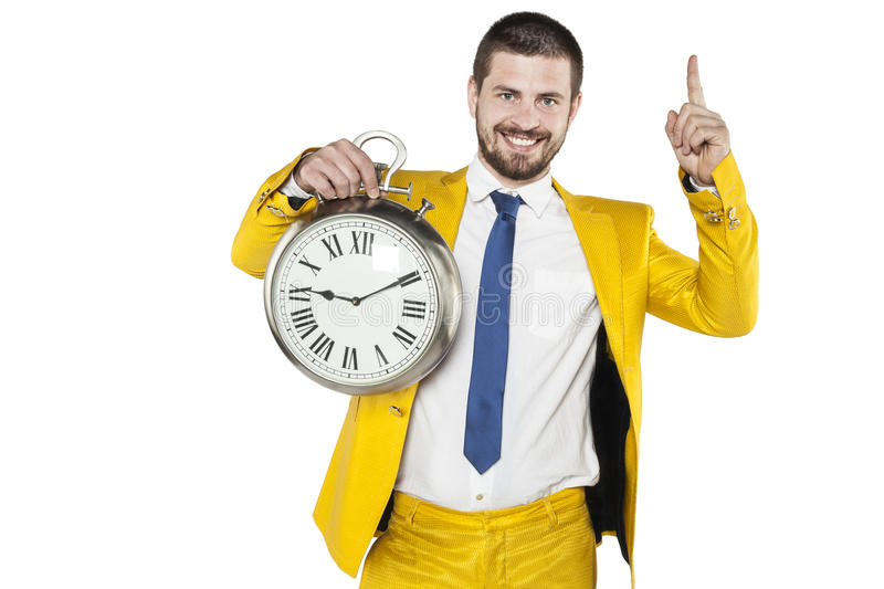 Businessman in a gold suit holding a clock in his hands. Business man in a gold suit holding a clock in his hands stock images