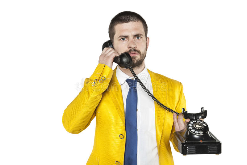 Businessman in a gold suit leads the telephone conversation. Business man in a gold suit leads the telephone conversation stock photography