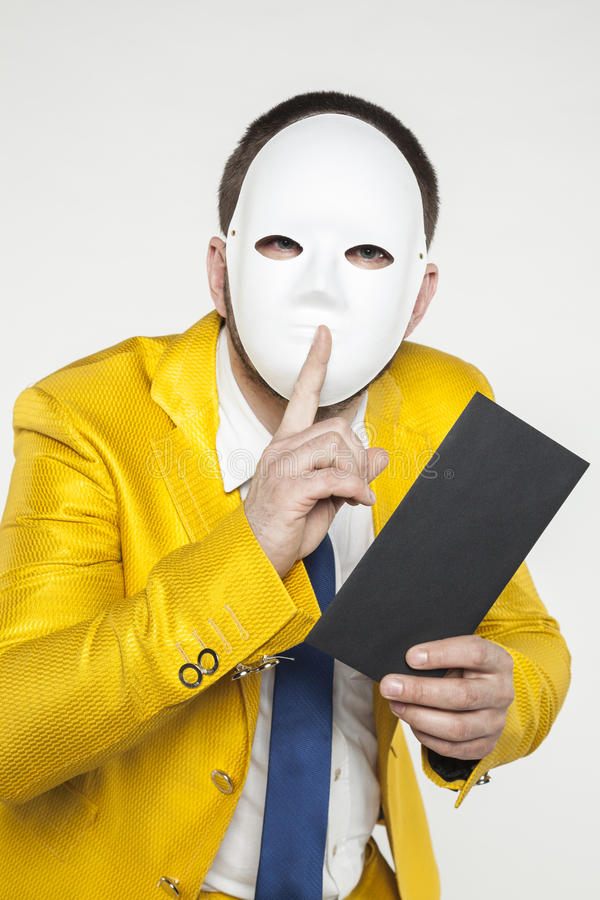 Businessman in a gold suit, performs quietly gesture. On the withe background stock image