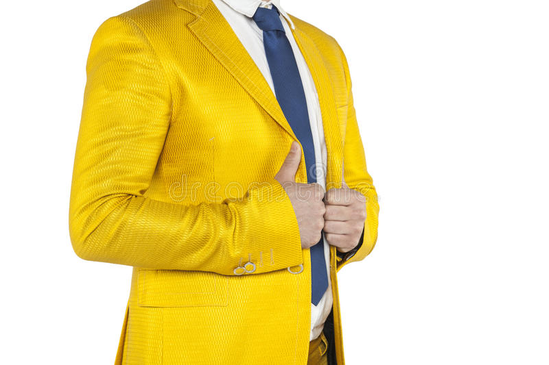 Businessman in a gold suit stands profile. Isolated on the withe background royalty free stock image