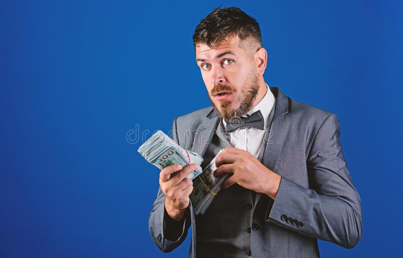 Businessman got cash money. Get cash easy and quickly. Cash transaction business. Man formal suit hold pile of dollar royalty free stock image