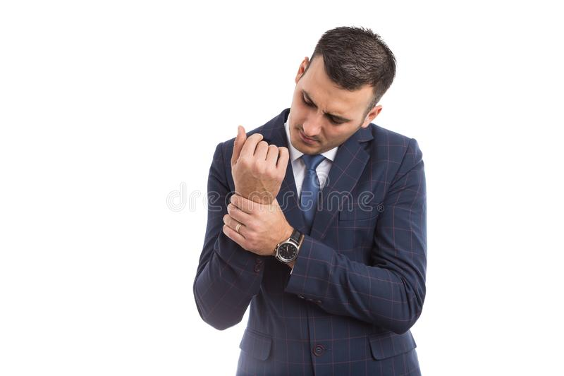 Businessman grabbing his painful wrist. As physical injury or health insurance concept royalty free stock photo