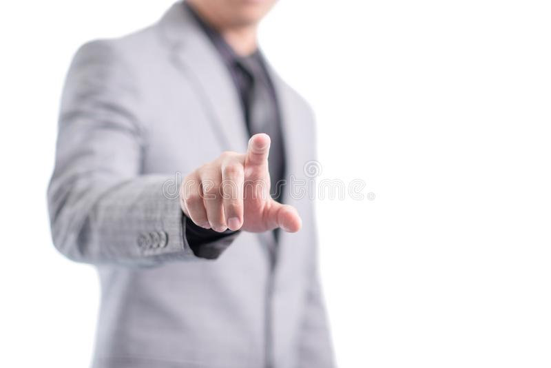Businessman in gray suit is pointing his finger to touch the screen, isolated royalty free stock photography