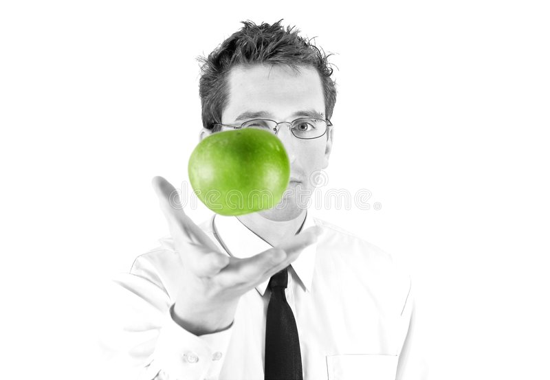 Businessman with green apple. Young businessman with green aple B&W design royalty free stock image