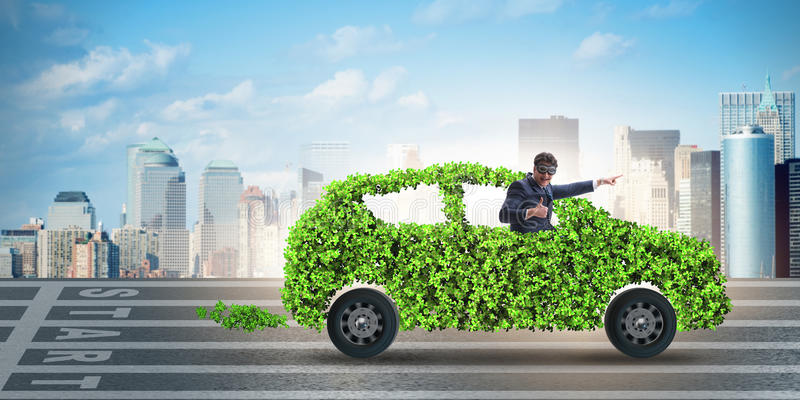 The businessman in green electric car concept stock photography