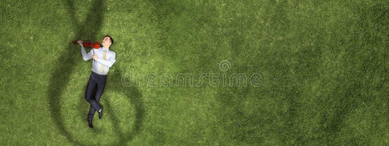 Businessman on green grass stock image