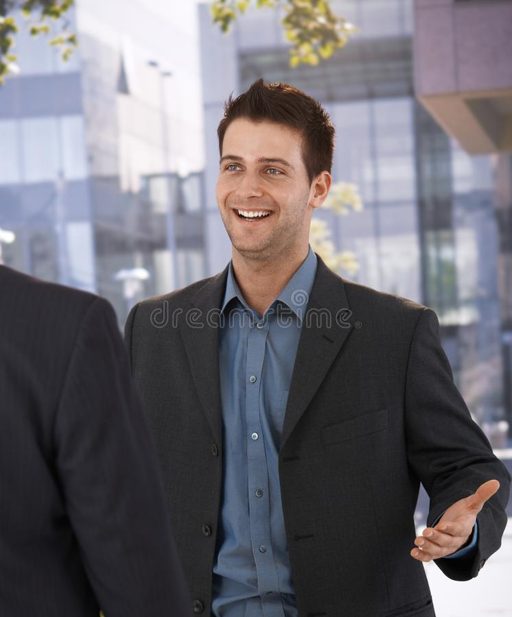 Download Businessman Greeting Colleague At Office Stock Image - Image: 20531847
