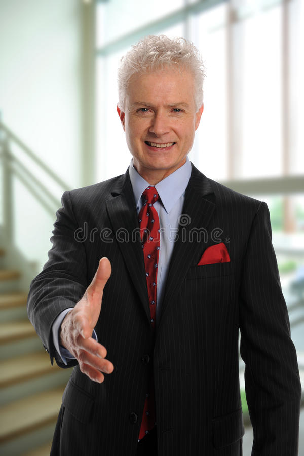 Businessman greeting with handshake royalty free stock images
