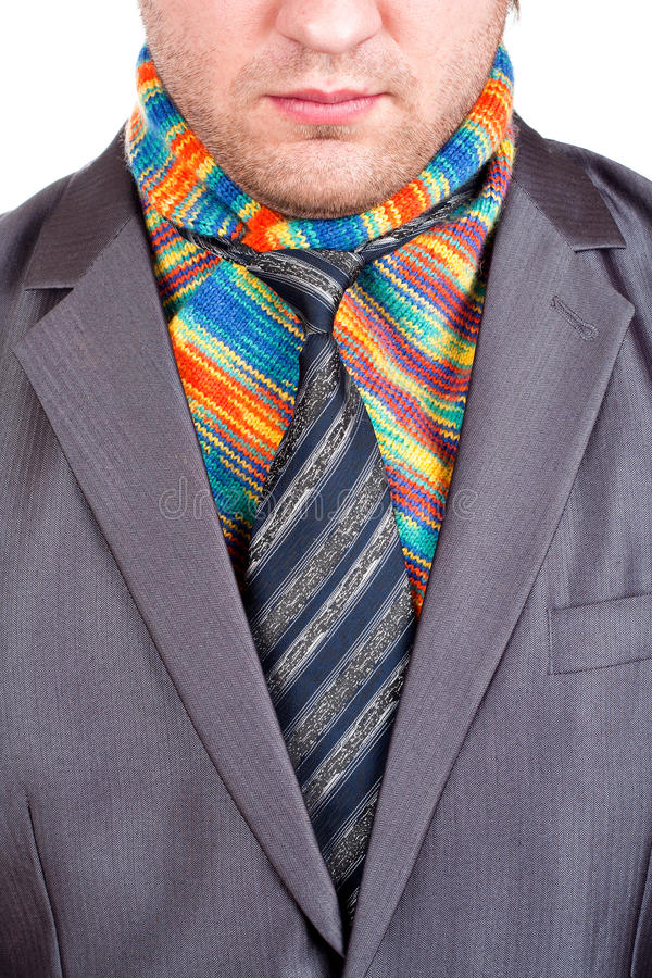 Businessman in grey suit and colorful scarf. Businessman in formal grey suit and colorful scarf stock image