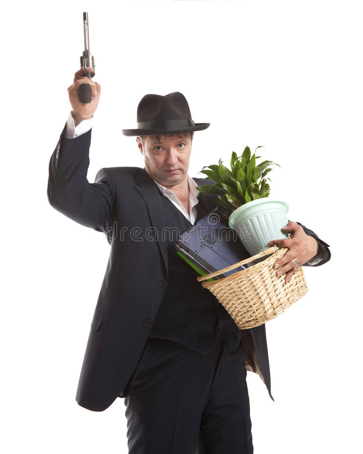 Businessman with gun hold personal belongings. Businessman in suit and hat with gun hold basket with personal belongings on white background royalty free stock photo